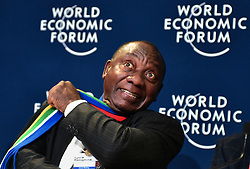 January 25, 2018 - Davos, Switzerland -  South Africa president in waiting CYRIL RAMAPHOSA has a little fun prior to a press conference at the Davos Conference Hall as leaders attend the final days of the World Economic Forum in Davos,Switzerland. (Credit Image: © Jeff Widener via ZUMA Wire)