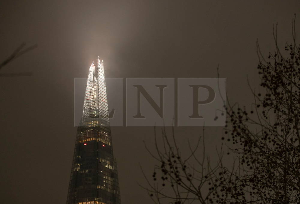 © Licensed to London News Pictures. 21/01/2019. London, UK. Low clouds over the Shard in central London denied stargazers sight of the full super blood wolf moon during it's blood red eclipse period. The first full moon of 2019 is a super moon as it appears brighter and it passes much closer to earth. Photo credit: Peter Macdiarmid/LNP