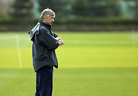 Photo: Chris Ratcliffe.<br /> Arsenal Training Session. UEFA Champions League. 18/04/2006.<br /> Arsene Wenger keeps a tab on the time during training