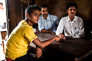 Village Child Protection Committee (VCPC) members (L-R) Dhundi Raj Tiwari (20), Mahanan Acharya (40), and Durga Prasad Bhatarai (46), speak of their work and the issues of child marriage  in Lekhapharsa vilage, Surkhet district, Western Nepal, on 30th June 2012. The VCPC works to intervene in child marriages such as the case of Pramila and is supported by Save the Children and local NGO Safer Societies. In Surkhet, StC partners with Safer Society, a local NGO which advocates for child rights and against child marriage. Photo by Suzanne Lee for Save The Children UK