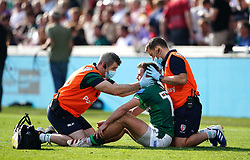 A concussion check is performed on London Irish's Ben White during the Gallagher Premiership match at the Brentford Community Stadium, London. Picture date: Sunday September 26, 2021.
