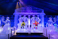 © Licensed to London News Pictures. 16/11/2017. London, UK. Jack Dury aged 3 and Ruby Darrah aged 3 sit on the thrones of a large ice sculpture on display as part of the Deep Sea Adventure. The Magical Ice Kingdom is the largest indoor ice and snow sculpture experience in Europe and part of the Hyde Park Winter Wonderland. Photo credit: Ray Tang/LNP