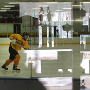 Hamden High School ice hockey players during a training session at Hamden High School with the trophy cabinet reflected in the ringside glass, Hamden, Connecticut, USA. 20th February 2014. Photo Tim Clayton