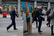 An employee from an insurance company walks through the City of London, visiting specific addresses relevant to the man appearing in a beach portrait whose 50th birthday it is, part of a creative and fun idea for the companys Christmas party, on 14th December 2017, in the City of London, England.