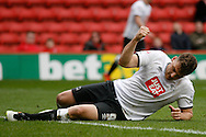 Chris Martin of Derby County thumping the pitch in disgust after his shot went over the crossbar Skybet football league championship match, Charlton Athletic v Derby County at The Valley  in London on Saturday 16th April 2016.<br /> pic by Steffan Bowen, Andrew Orchard sports photography.