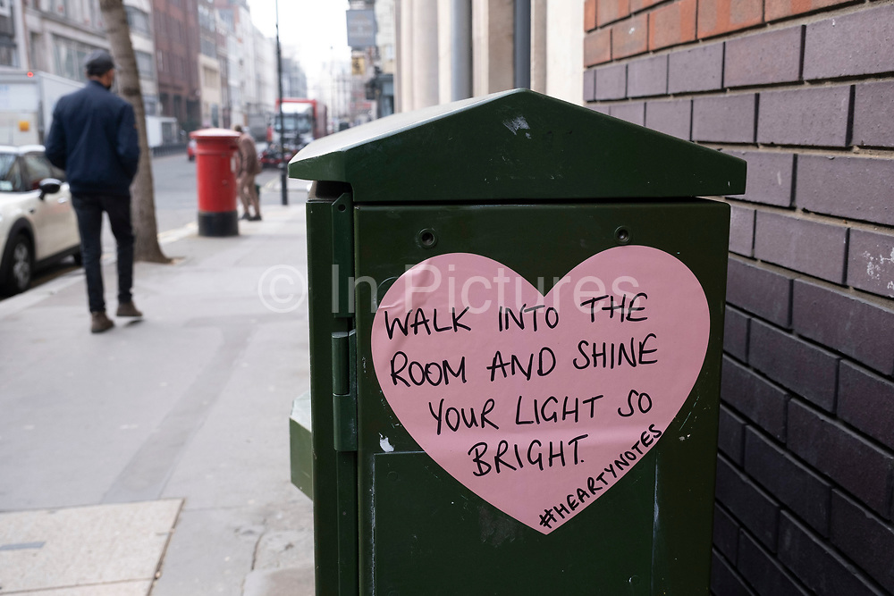 Street poetry heart reads walk into the room and shine your light so bright on 3rd March 2021 in London, England, United Kingdom. Notes such as this are a common sight offering poetic and inspirational words for passers by.