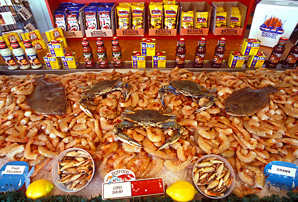 Stock photo of fresh shrimp, crabs, and fish on ice ready to be cooked