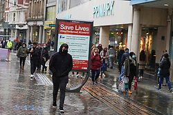 © Licensed to London News Pictures 28/10/2020. Nottingham  , UK. Shoppers wearing face masks walk  in the city centre before new restrictions come into force in Nottingham. The county of Nottinghamshire will enter into Tier 3 ,from 00:01 am on Friday 30 October. Photo credit: Ioannis Alexopoulos/LNP