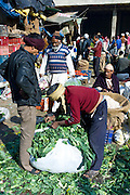Old Delhi, Daryagang fruit and vegetable market, cauliflower leaves for animal feed, India
