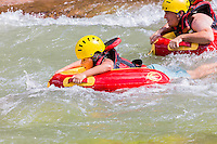 ADULTOS Y UN NINO DE 8 ANOS HACIENDO HYDROSPEED, RIVERBOARDING O COOL RIVER EN EL RIO ATUEL, VALLE GRANDE, SAN RAFAEL, PROVINCIA DE MENDOZA, ARGENTINA (PHOTO BY © MARCO GUOLI - ALL RIGHTS RESERVED)<br /> <br /> Riverboarding is a boardsport in which the participant lies prone on their board with fins on their feet for propulsion and steering. This sport is also known as hydrospeed in Europe and as riverboarding or white-water sledging in New Zealand, depending on the type of board used.[1][2] Riverboarding includes commercial, recreational and the swiftwater rescue practice of using a high-flotation riverboard, designed for buoyancy in highly aerated water (Wikipedia).
