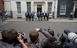 © Licensed to London News Pictures. 08/07/2015. London, UK. Photographers line up to photograph British Chancellor of the Exchequer, GEORGE OSBORNE and members of the Treasury team as they pose on the step of Number 11 Downing Street holding the Red box containing the first fully Conservative budget in 19 years.  Photo credit: Ben Cawthra/LNP