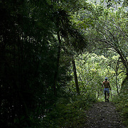 A solitary hiker makes her way down the trail on the island of Maui.