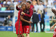 Portugal Midfielder Ricardo Quaresma and Portugal Forward Cristiano Ronaldo celebrate with emotion during the Euro 2016 final between Portugal and France at Stade de France, Saint-Denis, Paris, France on 10 July 2016. Photo by Phil Duncan.