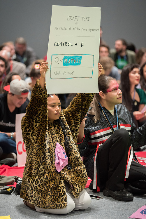 13 December 2019, Madrid, Spain: As COP25 is about to draw to a close, hundreds of young people mobilize through Fridays for Future in a strike for the climate, inside and outside the venue of COP25 in Madrid, calling for urgent action for climate justice. Here, an indigenous woman holds a sign illustrating the lack of human rights language in Article 6 of the Paris Agreement.