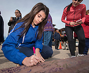 DeBakey High School for Health Professionals students, staff and alumni sign a beam that will help support the entry to the new school, January 27, 2016.
