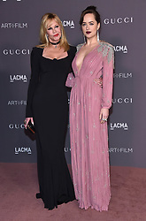 November 5, 2017 - Los Angeles, California, USA - 11/4/17.Melanie Griffith and Dakota Johnson at The 2017 LACMA Art+ FIlm Gala in Los Angeles, CA. (Credit Image: © Starmax/Newscom via ZUMA Press)