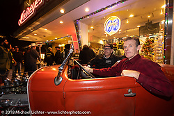 Bryan Thompson behind the wheel with Noise Cycles' Scott Jones riding shotgun at the Mooneyes Area-1 afterparty for overseas guests after their Yokohama show. Monday, December 3, 2018. Photography ©2018 Michael Lichter.