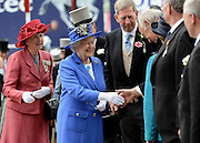 © Licensed to London News Pictures. 02/06/2012. London, UK. HRH Queen Elizabeth at The Investic Derby Festival today 2nd June 2012. The Royal Jubilee celebrations. Great Britain is celebrating the 60th  anniversary of the countries Monarch HRH Queen Elizabeth II accession to the throne this weekend Photo credit : Stephen Simpson/LNP