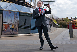 © Licensed to London News Pictures. 15/04/2021. London, UK. London Mayoral Candidate Brian Rose records a video in front of the Cutty Sark while canvassing in Greenwich, South East London. The London Mayoral Election is expected to take place on the 6th of May after it was postponed last year due to the coronavirus pandemic . Photo credit: George Cracknell Wright/LNP
