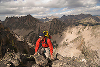 A young man climbs the north ridge of Packrat Peak in the Sawtooth Mountains, Idaho.