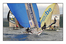The 2004 Skiff Nationals at Largs held by the SSI.<br /> <br /> Largs Boys helmed by Alan Bunion approach  the leeward mark.<br /> <br /> Marc Turner / PFM Pictures