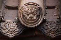 Tiger face in roof tiles. Details from the Taoist Bai Long Wang Miao, White Dragon King Temple, Beiyue Hengshan Mountain, Datong, Hunyuan County, Shanxi Province, China