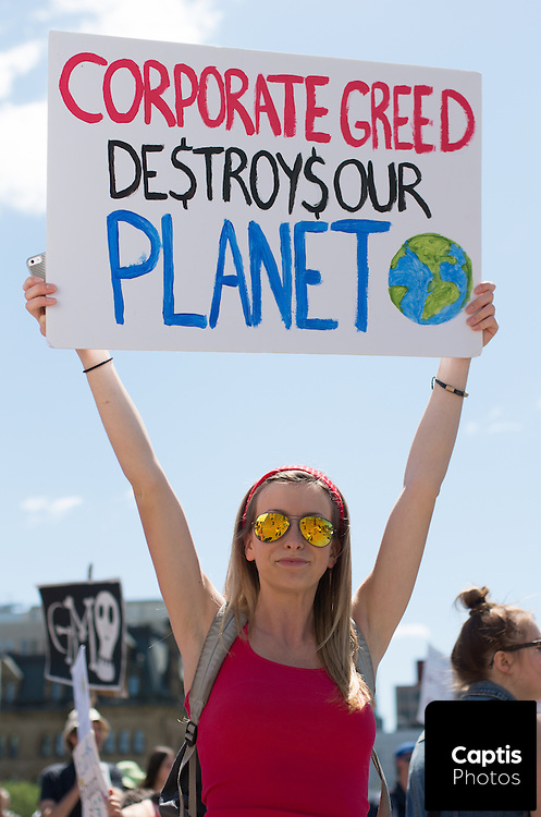 A women poses for a photo while protesting GMOs on Parliament Hill. May 31, 2014.