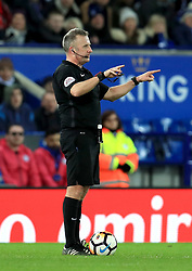 Match referee Jon Moss signals that VAR is in use