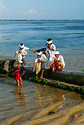 Local boys playing on beach. Sanur, Bali, Indonesia