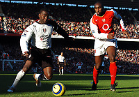 Photo: Javier Garcia/Back Page Images<br />Arsenal v Fulham, FA Barclays Premiership, Highbury, 26/12/04<br />Andy Cole tries to find a way past Sol Campbell