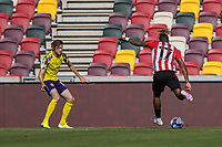 Football - 2020 / 2021 Sky Bet (EFL) Championship - Brentford vs. Huddersfield Town <br /> <br /> Ivan Toney (Brentford  FC) prepares to strike towards the Huddersfield goal at the Brentford Community Stadium<br /> <br /> COLORSPORT/DANIEL BEARHAM
