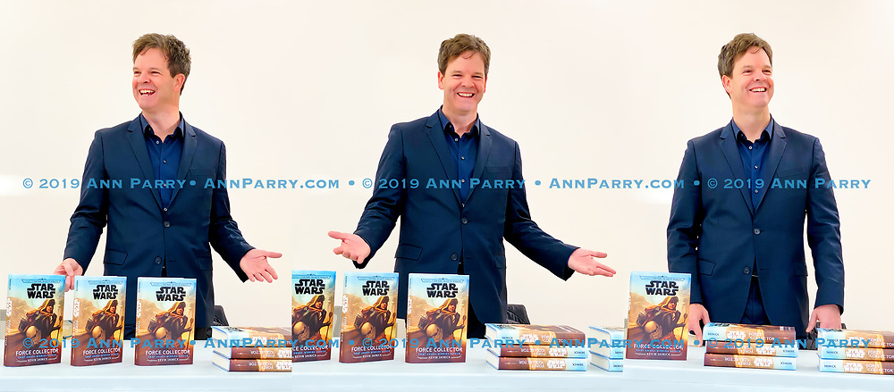 Merrick, New York, U.S. December 20, 2019. KEVIN SHINICK, shown in composite of 3 photos, discusses his novel during book signing for his STAR WARS: FORCE COLLECTOR at North Merrick Library on Nassau County Force Collector Day. Author Shinick named home planet of Karr Nuq Sin, the main character of this canon Star Wars young adult novel, MEROKIA in honor of Merokee tribe who settled his Merrick hometown on Long Island.