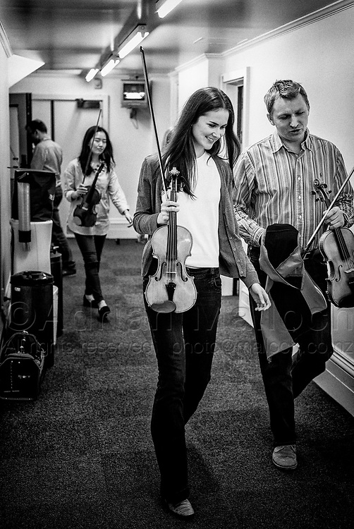 Milena Parobczy and Artur Grabczewski head towards the green room after rehearsal at the Auckland Town Hall.
