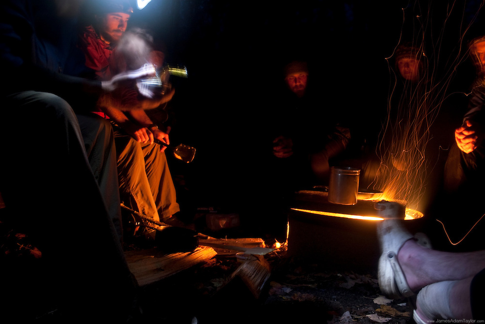 The night before the last climb up Mt. Katahdin, Thru-Hikers at the Birches shelter enjoy their last dinner as hikers on the Appalachian Trail. Baxter State Park, Maine.