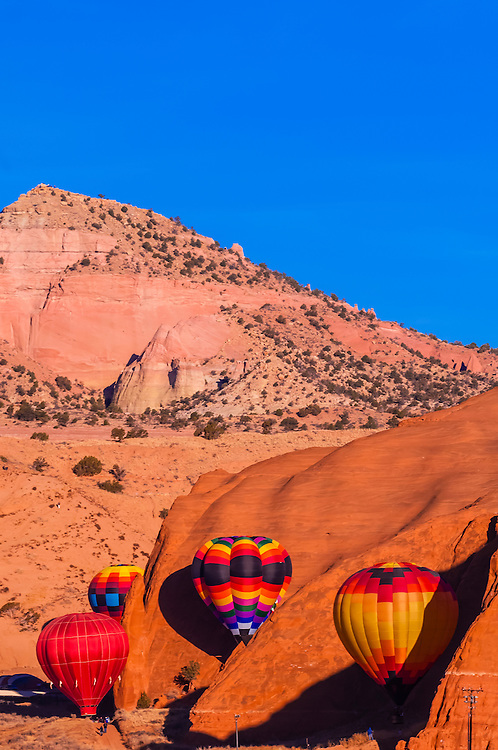 Aerial view of hot air balloons flying during the Red Rock Balloon Rally, Red Rock State Park, near Gallup, New Mexico USA.