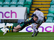 Northampton Saints centre Fraser Dingwall tackles Sale Sharks full back Simon Hammersley during a Gallagher Premiership Round 13 Rugby Union match, Saturday, Mar. 12, 2021, in Northampton, United Kingdom. (Steve Flynn/Image of Sport)