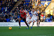 Walsall's Romaine (l)breaks away from Tranmere Rovers Ash Taylor. Skybet football league 1 match, Tranmere Rovers v Walsall at Prenton Park in Birkenhead, England on Saturday 11th Jan 2014.<br /> pic by Chris Stading, Andrew Orchard sports photography.