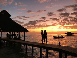 EXCLUSIVE: How about owning your own tropical Caribbean luxury resort for just $10. American couple Suzanne and Dave Smith are selling off their incredible Casa Cayuco Eco Adventure Lodge, in Bocas del Toro, Panama, Central America. But instead of listing their stunning multi-million-pound island getaway for sale they are offering the chance for anyone who buys a $10 ticket to win their extraordinary lifestyle and profitable business. Dave and Suzanne have spent five years turning a former rustic lodge into one that has just been voted number one resort on TripAdvisor in Panama. Their incredible two-acre slice of heaven is bordered by sloth-filled rainforest to the rear and crystal clear coral sea to the front. The lucky winner of the 24-guest resort will become owner of four stand-alone cabins, a main lodge, two lodge suites, and an air-conditioned luxury owner's suite designed by Dave and Suzanne themselves and built by skilled local carpenters. Outside, Casa Cayuco comes with its own jetty and thatch covered sun terrace as well as everything you need to run a business, including commercial kitchen communication tower, laundry and maintenance building and THREE power boats, each over 23-foot long. Kayaks, snorkelling, spear fishing and paddle boards and surf gear are also ready and waiting to be used by a new owner and guests alike. And if that's not enough, British competition organisers WinThis.Life https://winthis.life/index.aspx# are offering a $50,000 cash injection to welcome the new owners. All those wishing to take part have to do is buy one or more tickets and play a spot-the-ball-type competition on the website. Entries are being taken extension until April 11. Dave, 35, and Suzanne, 33, first arrived on the island in 2013 with just seven suitcases having decided to sell up from their home and corporate lives near Detroit, Michigan, USA. 16 Feb 2018 Pictured: Pic shows sunset at the Caribbean resort Casa Cayuco in Panama which one lucky winner could