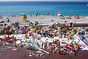 © Licensed to London News Pictures. 29/07/2016. Nice, FRANCE Flowers and tributes in Nice, France, today 29th July 2016 two weeks after a terrorist attack left 84 dead. On the evening of 14 July 2016, 84 people were killed and 308 injured when a 19 tonne cargo truck was deliberately driven into crowds celebrating Bastille Day on the Promenade des Anglais in Nice, France. Photo credit : Stephen Simpson/LNP