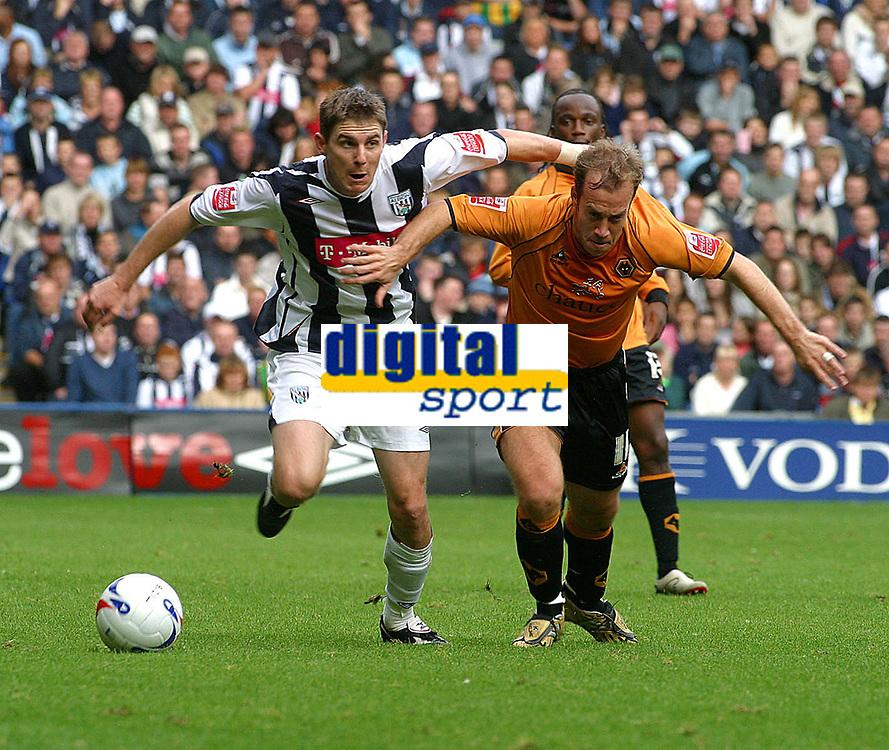 Photo: Dave Linney.<br />West Bromwich Albion v Wolverhampton Wanderers. Coca Cola Championship. 22/10/2006. West Brom's Zoltan Gera(L) powers his way past  Jamie Clapham
