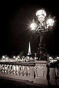 The Eiffel Tower at night from Pont Alexandre III, Paris, France
