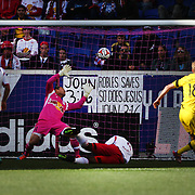 Goalkeeper Luis Robles, New York Red Bulls, doesn't  save this time as Aaron Schoenfeld, Columbus Crew, scores the first of his two goals during the New York Red Bulls Vs Columbus Crew, Major League Soccer regular season match at Red Bull Arena, Harrison, New Jersey. USA. 19th October 2014. Photo Tim Clayton