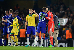 LONDON, ENGLAND - Wednesday, December 10, 2014: Chelsea's substitute Ruben Loftus-Cheek gets a hug from goalkeeper Petr Cech after making his debut against Sporting Clube de Portugal during the final UEFA Champions League Group G match at Stamford Bridge. (Pic by David Rawcliffe/Propaganda)