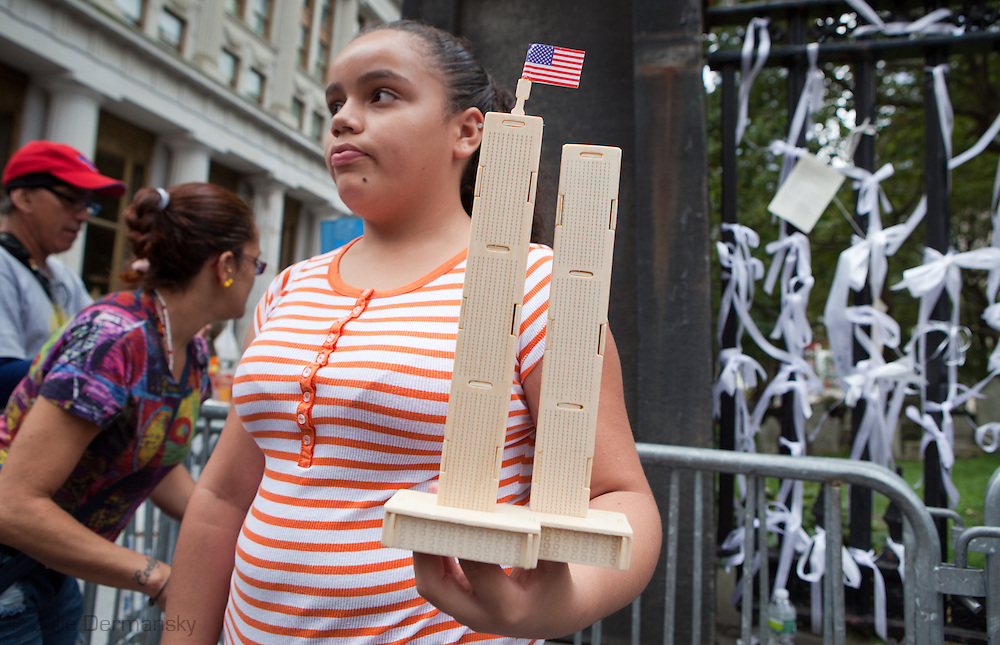 Woman selling cardboard version of the World Trade Center near ground zero on 10th anniversary of the 9/11.<br /> New York City  commemorated the 10th anniversary of the 9/11 attacks on the World Trade Center towers despite new credible threats of terrorism.