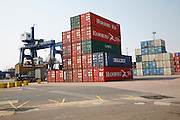 Stacked shipping containers and crane, Port of Felixstowe, Suffolk, England