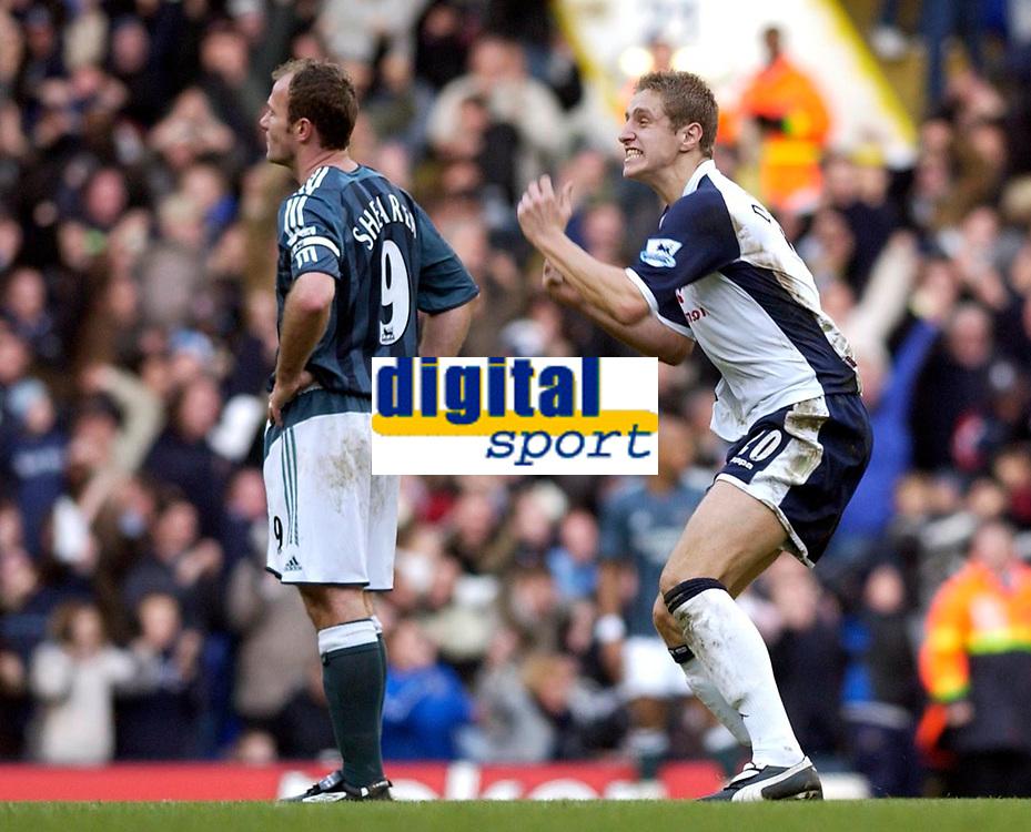 Photo: Daniel Hambury.<br />Tottenham Hotspur v Newcastle United. The Barclays Premiership. 31/12/2005.<br />Tottenham's Michael Dawson (R) celebrates his sides second goal as Newcastle's Alan Shearer looks on gutted.