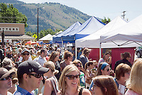 Hundreds of tourists and locals alike crowd the Jackson Hole Farmers' Market on Saturday in the Jackson Town Square. The Farmers' Market pops up every Saturday morning on the square until noon.