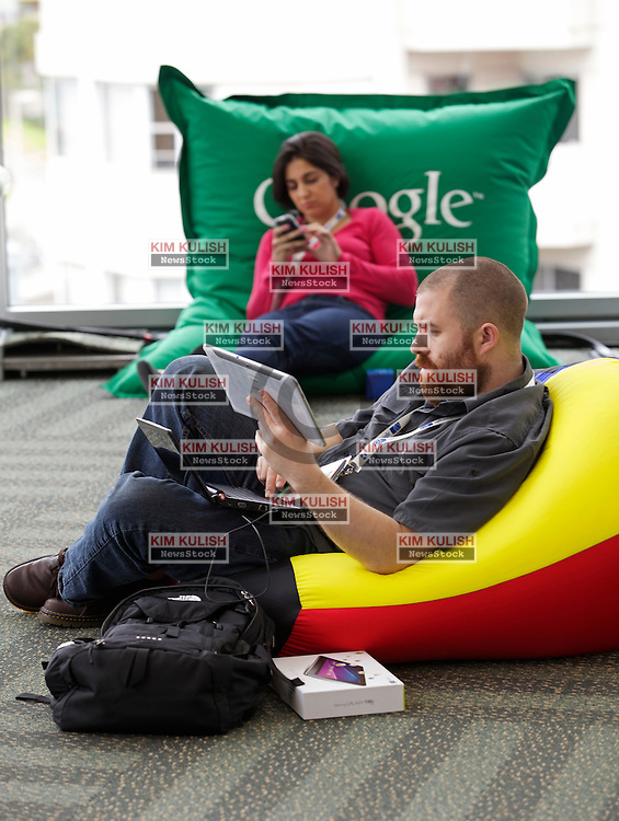 Some of the over  5000 computer software and hardware developers attending the annual  Google I/O conference in San Francisco, California, take a break to rest and check their email.