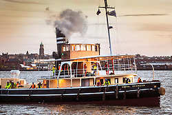 """© Licensed to London News Pictures. 04/05/2016. Birkenhead UK. Picture shows the Daniel Adamson making it's first public appearance for 30 years traveling across the Mersey last night from the Camel Laird ship yard to Canning Dock in Liverpool. The Daniel Adamson steam boat has been bought back to operational service after a £5M restoration. The coal fired steam tug is the last surviving steam powered tug built on the Mersey and is believed to be the oldest operational Mersey built ship in the world. The """"Danny"""" (originally named the Ralph Brocklebank) was built at Camel Laird ship yard in Birkenhead & launched in 1903. She worked the canal's & carried passengers across the Mersey & during WW1 had a stint working for the Royal Navy in Liverpool. The """"Danny"""" was refitted in the 30's in an art deco style. Withdrawn from service in 1984 by 2014 she was due for scrapping until Mersey tug skipper Dan Cross bought her for £1 and the campaign to save her was underway. Photo credit: Andrew McCaren/LNP ** More information available here http://tinyurl.com/jsucxaq **"""