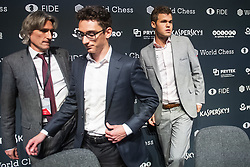 November 10, 2018 - London, GREAT BRITAIN - 181110 Daniel King, press officer, Fabiano Caruana of USA and Magnus Carlsen of Norway during a press conference after round 2 of The FIDE World Chess Championship 2018 on November 10, 2018 in London. .Photo: Fredrik Varfjell / BILDBYRÃ…N / kod FV / 150158 (Credit Image: © Fredrik Varfjell/Bildbyran via ZUMA Press)